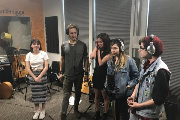 Youth on Record students singing on the Magic Giant track