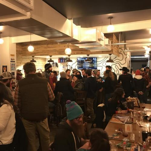 A full taproom at the Intrepid Sojourner Beer Project