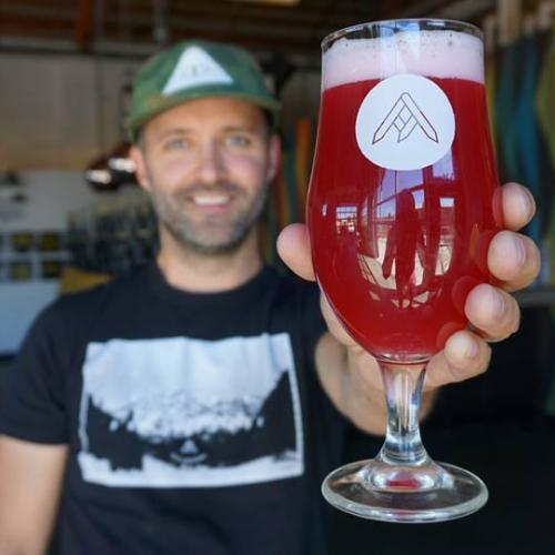 Jason zumBrunnen from Ratio Beerworks, holding a glass of beer